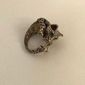 Leopard ring with emerald style eyes.